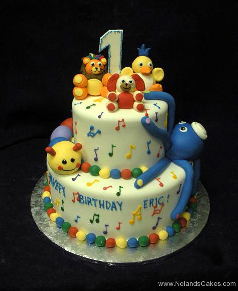 2207, first birthday, 1st birthday, animal, animals. octopus, caterpillar, bear, duck, lion, music, notes, primary, bright, tiered