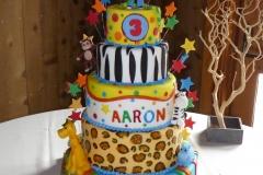 P1000032, third birthday, 3rd birthday, star, stars, jungle, lion, giraffe, monkey, zebra, hippo, elephant, yellow, leopard print, figures, tiered