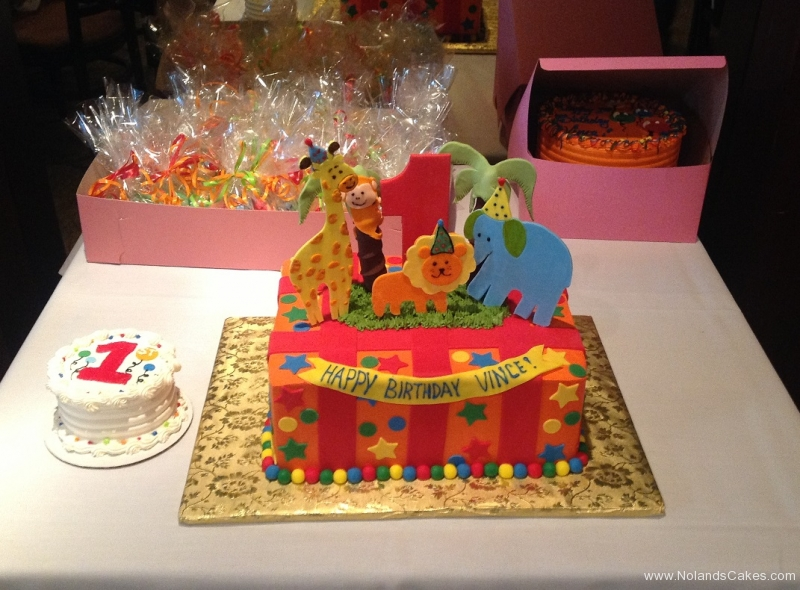 799, first birthday, 1st birthday, animals, animal, zoo, giraffe, elephant, lion, monkey, circus, red, orange, smash cake