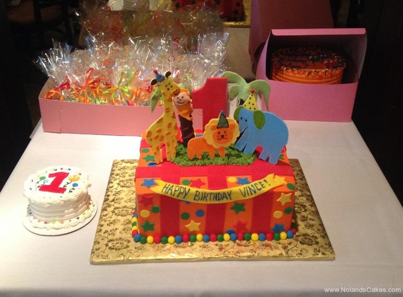 799, first birthday, 1st birthday, animals, animal, zoo, giraffe, elephant, lion, monkey, circus, red, orange, smash cake