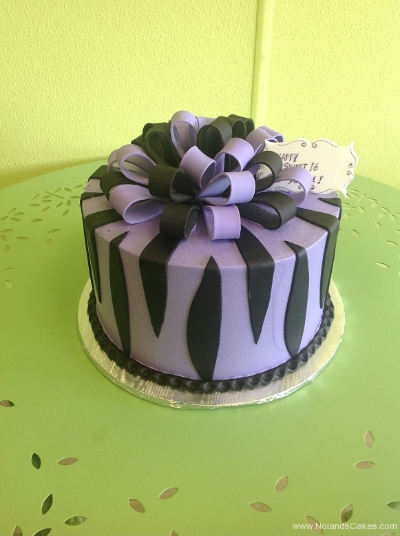 911, zebra, zebra print. animal, purple, black, ribbon, bow