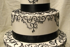 10, black, white, swirls, piping, scrolls, bow, topper, ribbon, elegant, tiered, three tiered,