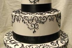 10, black, white, swirls, piping, scrolls, bow, topper, ribbon, elegant, tiered, three tiered,