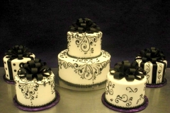 11, black, white, swirls, piping, scrolls, bow, topper, ribbon, elegant, tiered,  twp tiered, present, gift, multiple cakes